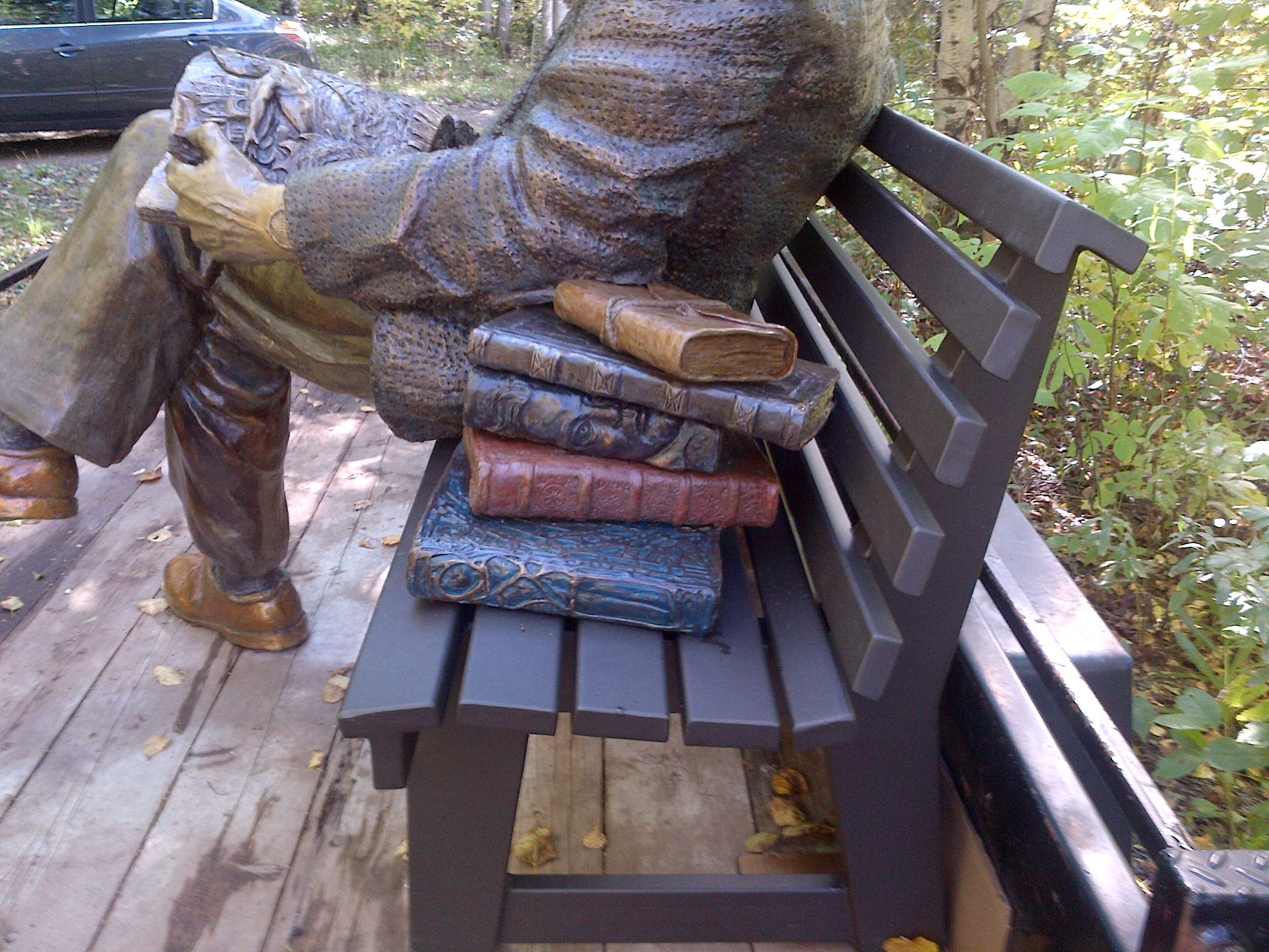 Northrop Frye Sculpture, (bronze) book detail Victoria University Toronto photo by Paul Gooch